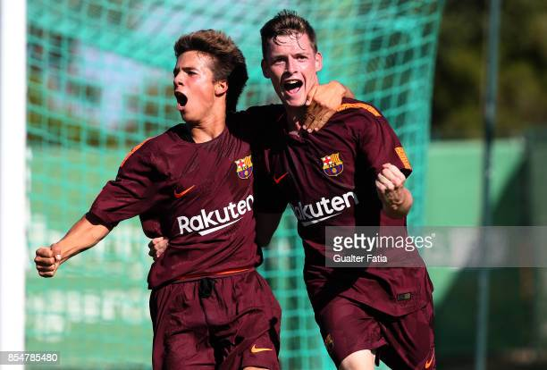 Barcelona's Sergio Gomez celebrates with teammate FC Barcelona Ricard Puig after scoring a goal during the UEFA Youth League match between Sporting...