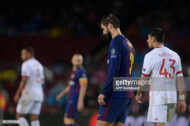 Barcelona's Spanish defender Gerard Pique leaves the field after receiving two yellow cards during the UEFA Champions League group D football match...