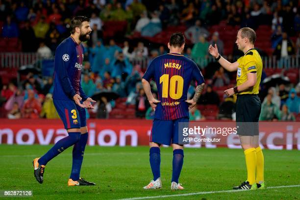 Barcelona's Spanish defender Gerard Pique protests to the referee during the UEFA Champions League group D football match FC Barcelona vs Olympiacos...