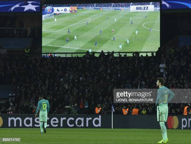 Barcelona's Spanish defender Gerard Pique reacts after the fourth goal scored by Paris SaintGermain's players during the UEFA Champions League round...