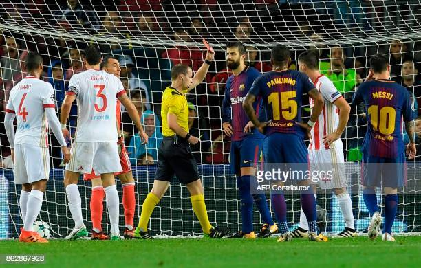 Barcelona's Spanish defender Gerard Pique receives a second yellow card during the UEFA Champions League group D football match FC Barcelona vs...