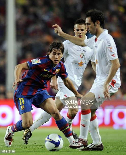 Barcelona's Spanish forward Bojan Krkic vies with Osasuna's Juanfran during their Spanish League football match on May 23 2009 at Camp Nou stadium in...
