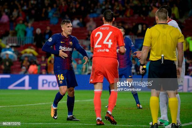 Barcelona's Spanish forward Gerard Deulofeu gestures during the UEFA Champions League group D football match FC Barcelona vs Olympiacos FC at the...