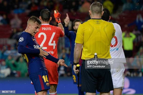 Barcelona's Spanish forward Gerard Deulofeu protests to the referee during the UEFA Champions League group D football match FC Barcelona vs...