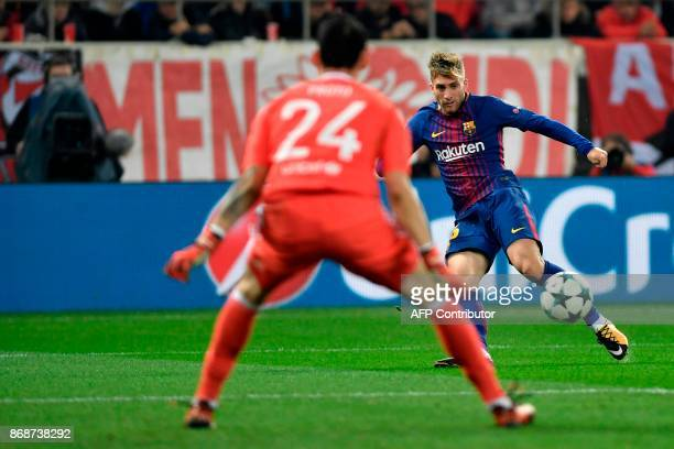 Barcelona's Spanish forward Gerard Deulofeu runs with the ball during the UEFA Champions League group D football match between FC Barcelona and...