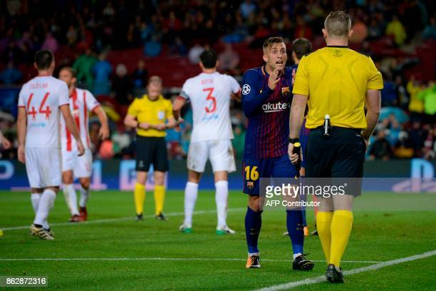 Barcelona's Spanish forward Gerard Deulofeu talks to the referee during the UEFA Champions League group D football match FC Barcelona vs Olympiacos...