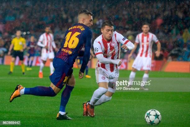 Barcelona's Spanish forward Gerard Deulofeu vies with Olympiacos' Greek forward Leonardo Koutris during the UEFA Champions League group D football...