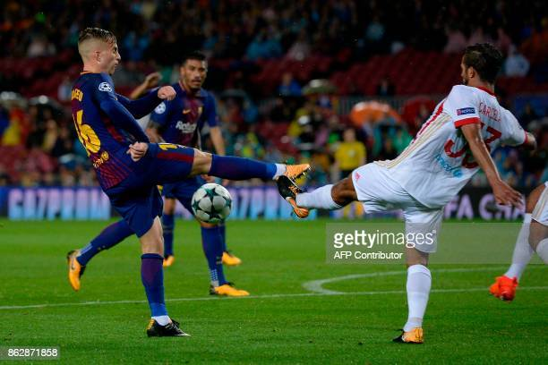Barcelona's Spanish forward Gerard Deulofeu vies with Olympiacos' Moroccan midfielder Mehdi CarcelaGonzalez during the UEFA Champions League group D...