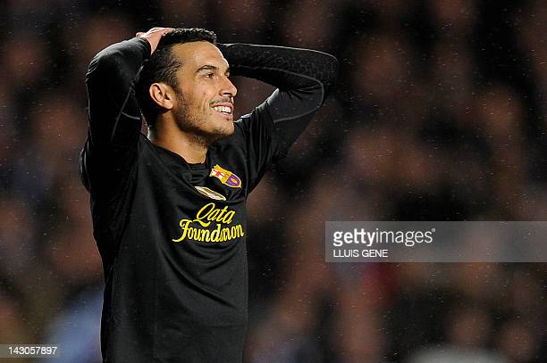 Barcelona's Spanish forward Pedro reacts during the UEFA Champions League semifinal first leg football match between Chelsea and Barcelona at...