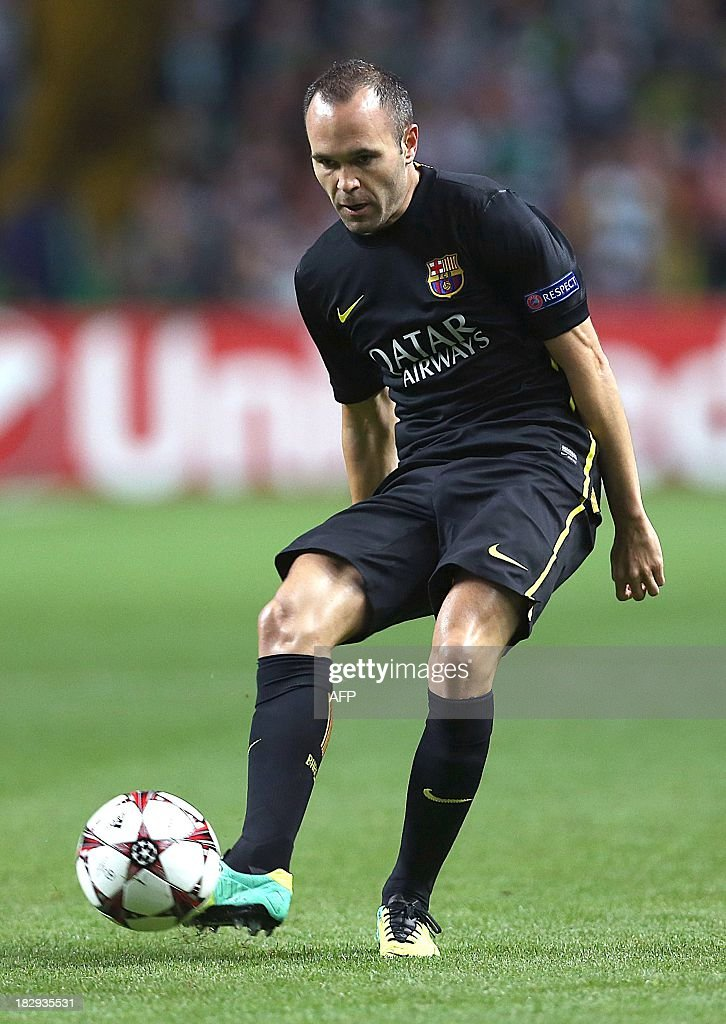 Barcelona's Spanish midfielder Andres Iniesta controls the ball during their UEFA Champions League Group H football match between Celtic and Barcelona at Celtic Park in Glasgow on October 1, 2012.