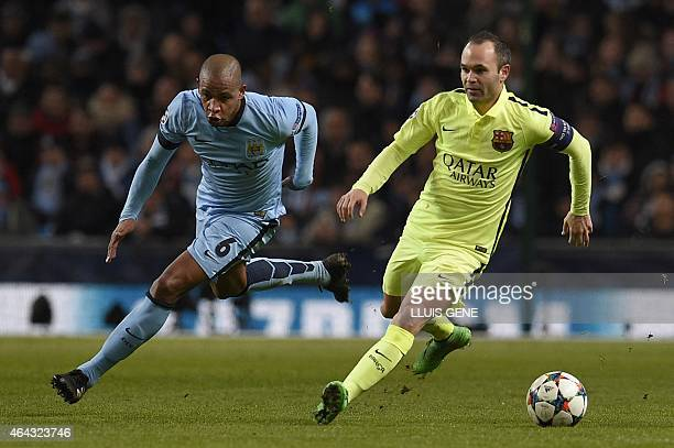 Barcelona's Spanish midfielder Andres Iniesta runs with the ball as Manchester City's Brazilian midfielder Fernando chases during the UEFA Champions...