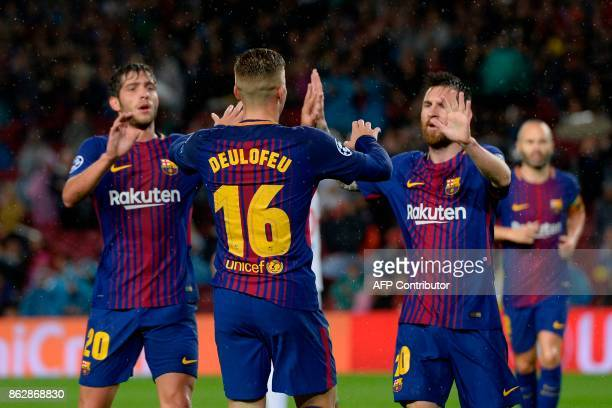 Barcelona's Spanish midfielder Sergi Roberto Barcelona's Spanish forward Gerard Deulofeu and Barcelona's Argentinian forward Lionel Messi celebrate a...