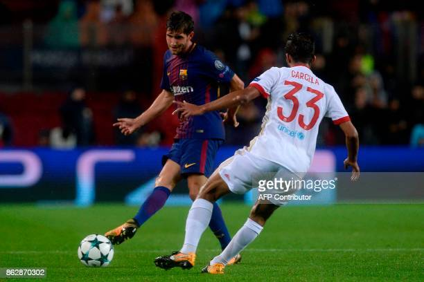 Barcelona's Spanish midfielder Sergi Roberto vies with Olympiacos' Moroccan midfielder Mehdi CarcelaGonzalez during the UEFA Champions League group D...