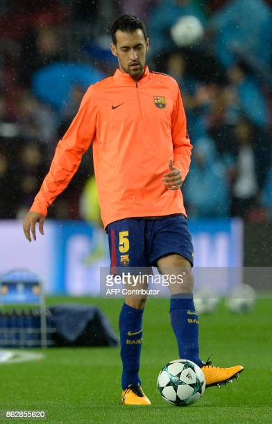 Barcelona's Spanish midfielder Sergio Busquets warms up before the UEFA Champions League group D football match FC Barcelona vs Olympiacos FC at the...