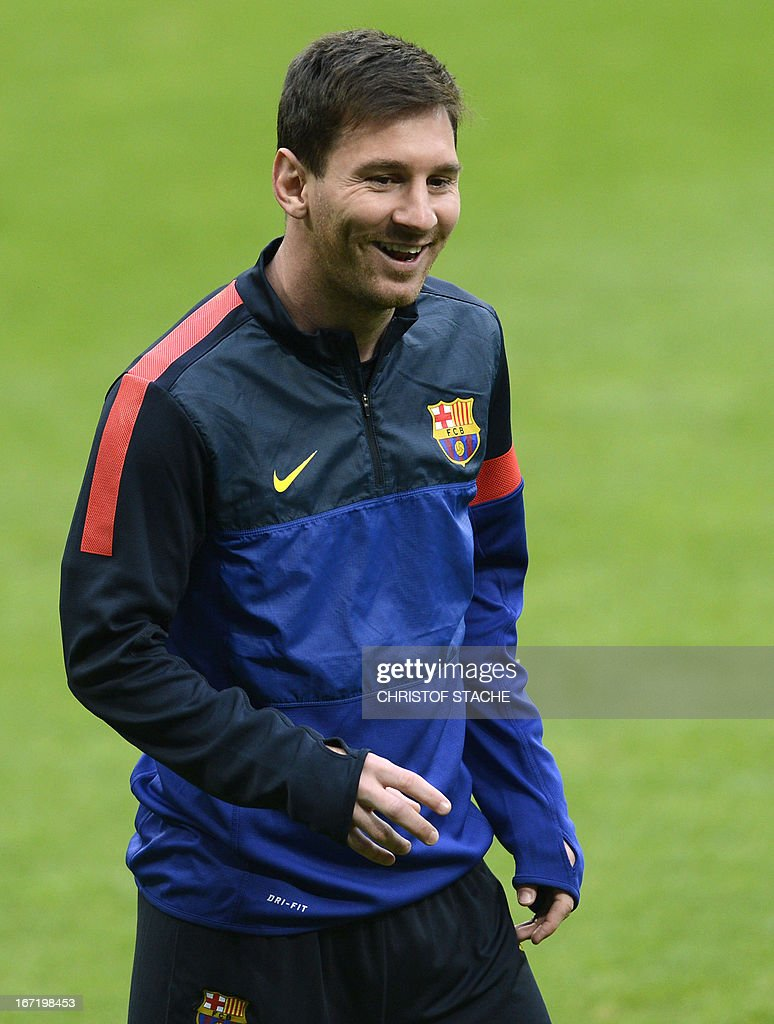Barcelona's striker Lionel Messi laughs during the final team training on the eve of the UEFA Champions League semi final first leg football match between FC Bayern Munich and FC Barcelona at the arena in Munich, southern Germany, on April 22, 2013. The semi final match will take place on April 23, 2013.