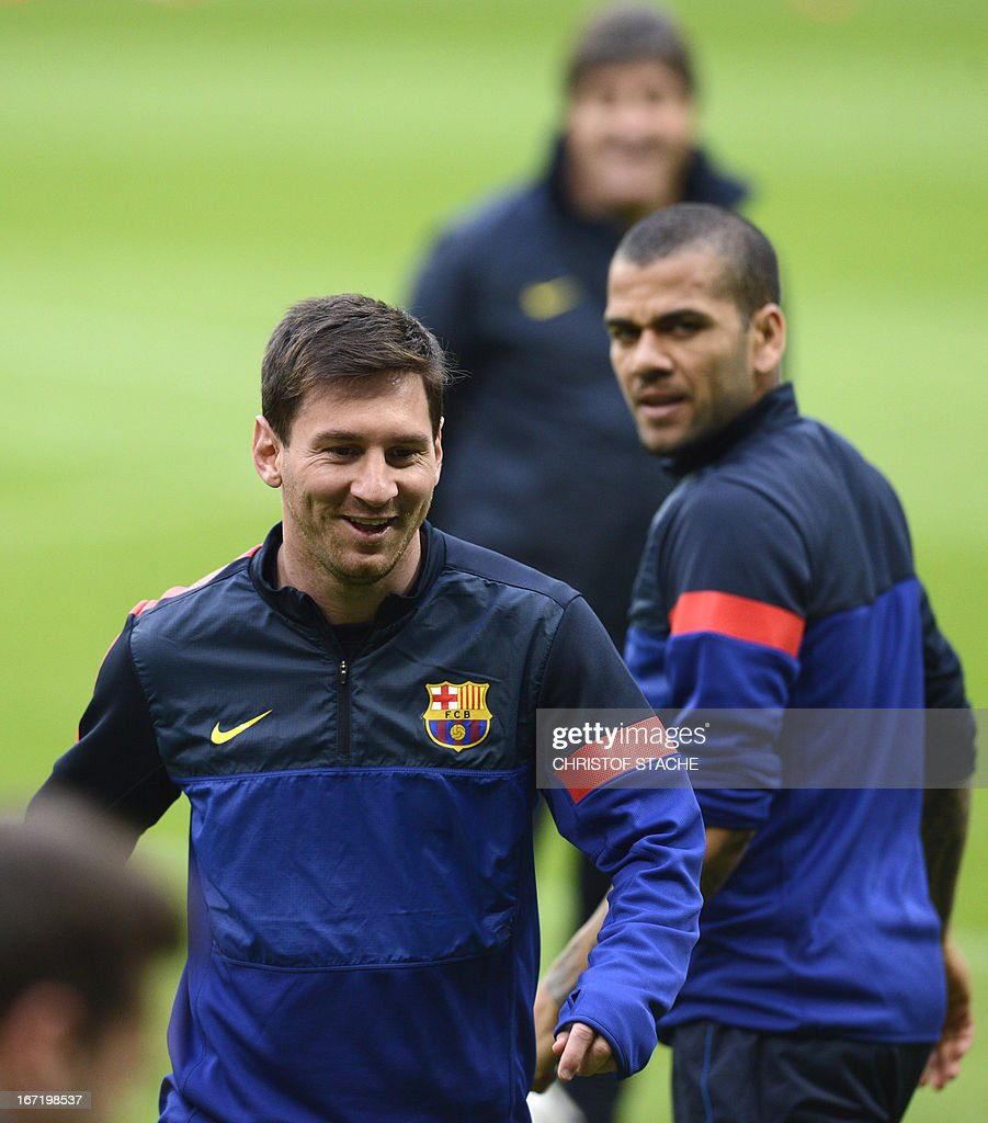 Barcelona's striker Lionel Messi (L) laughs during the final team training on the eve of the UEFA Champions League semi final first leg football match between FC Bayern Munich and FC Barcelona at the arena in Munich, southern Germany, on April 22, 2013. The semi final match will take place on April 23, 2013.