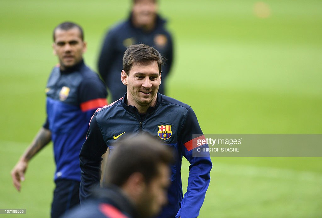 Barcelona's striker Lionel Messi (C) laughs during the final team training on the eve of the UEFA Champions League semi final first leg football match between FC Bayern Munich and FC Barcelona at the arena in Munich, southern Germany, on April 22, 2013. The semi final match will take place on April 23, 2013. AFP PHOTO/CHRISTOF STACHE
