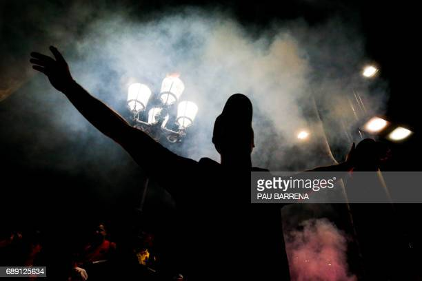 Barcelona's supporter sings as he celebrates their team's 29th Copa del Rey title at the Canaletes fountain on Las Ramblas in Barcelona on May 27...
