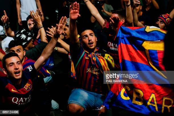 FC Barcelona's supporters celebrate their team's 29th Copa del Rey title at the Canaletes fountain on Las Ramblas in Barcelona on May 27 2017 after...