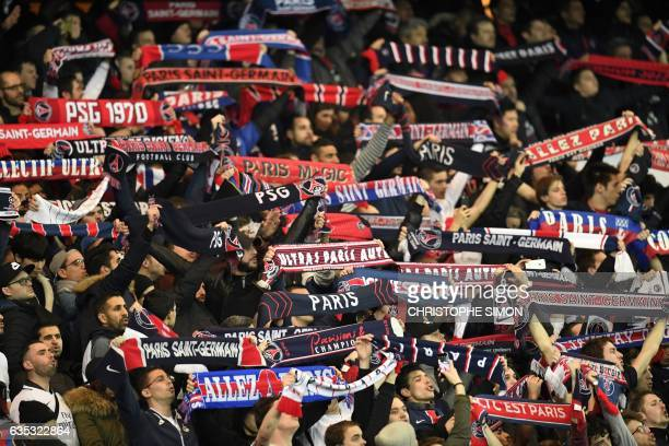 FC Barcelona's supporters cheer during the UEFA Champions League round of 16 first leg football match between Paris SaintGermain and FC Barcelona on...