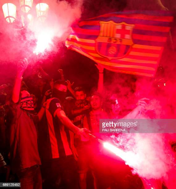 FC Barcelona's supporters hold flares as they celebrate their team's 29th Copa del Rey title at the Canaletes fountain on Las Ramblas in Barcelona on...