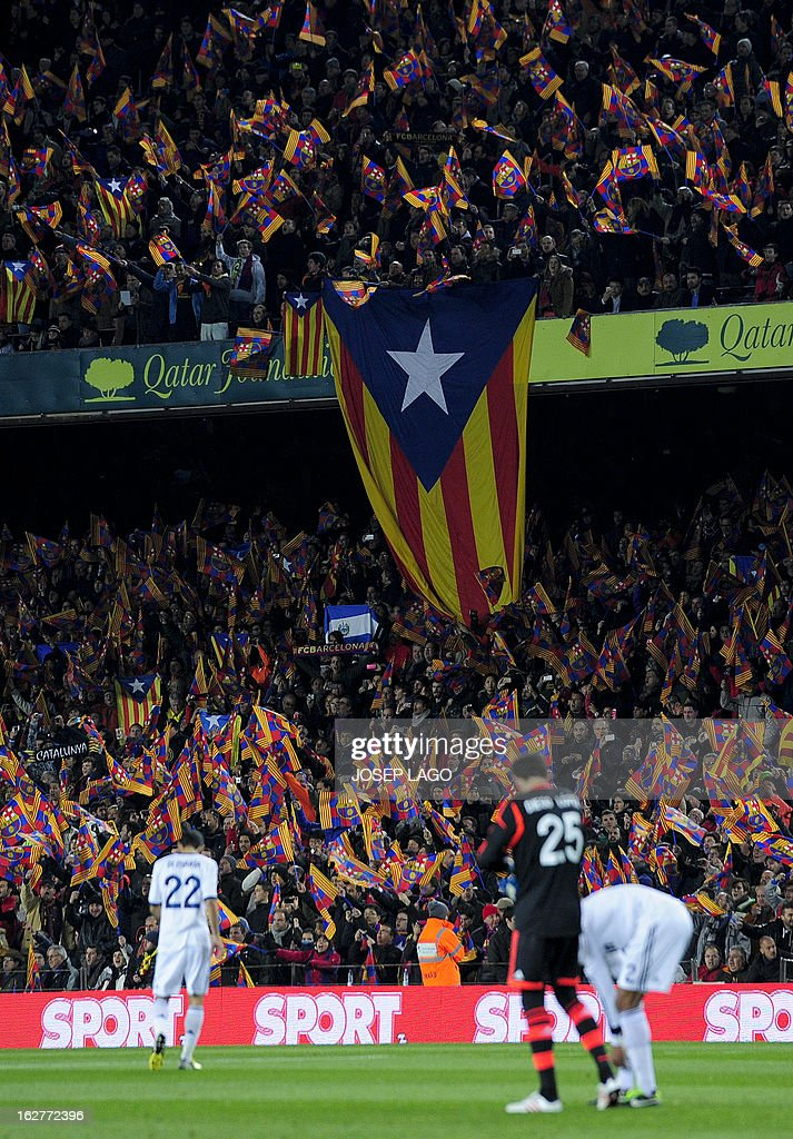 Barcelona's supporters shows an Estela flag (Cataln independentist flag) before the Spanish Cup semi-final second-leg football match FC Barcelona vs Real Madrid CF at the Camp Nou stadium in Barcelona on February 26, 2013. AFP PHOTO / JOSEP LAGO