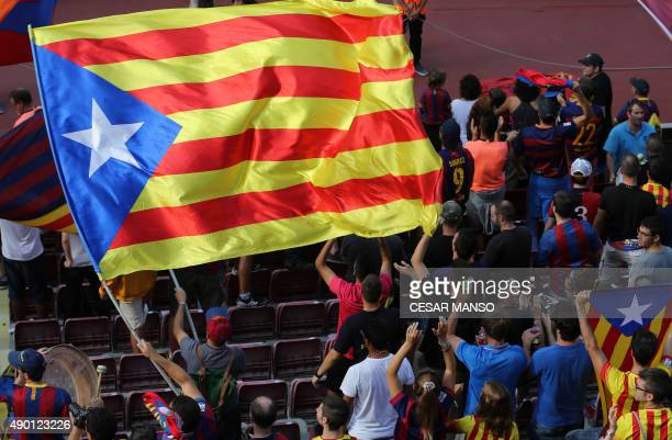 Barcelona's supporters wave a 'Estelada' proindependent Catalonia flag during the Spanish league football match FC Barcelona vs UD Las Palmas at the...