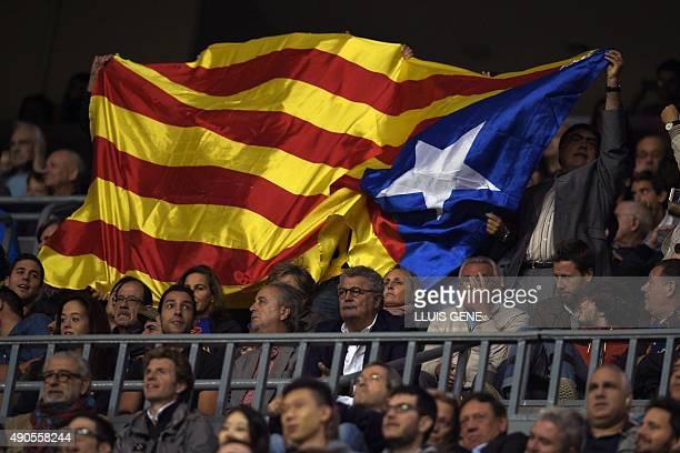 Barcelona's supporters wave a pro independece flag during the UEFA Champions League Group E football match between FC Barcelona and Bayer Leverkusen...