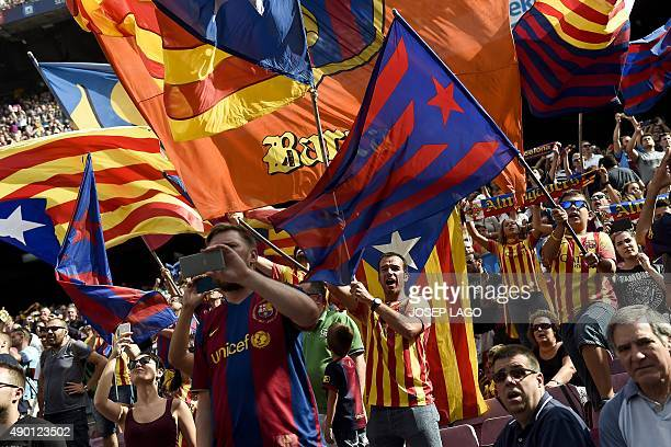 FC Barcelona's supporters wave 'esteladas' and FC Barcelona's flags before the Spanish league football match FC Barcelona vs UD Las Palmas at the...