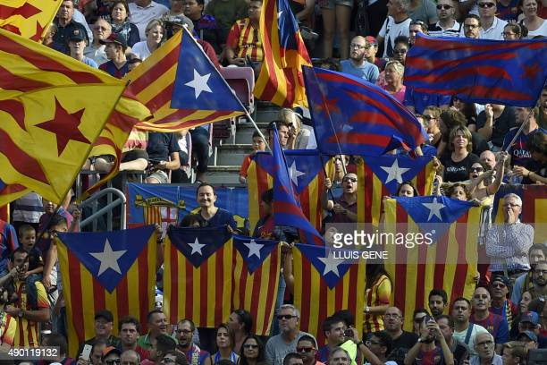 Barcelona's supporters wave 'Esteladas' during the Spanish league football match FC Barcelona v UD Las Palmas at the Camp Nou stadium in Barcelona on...