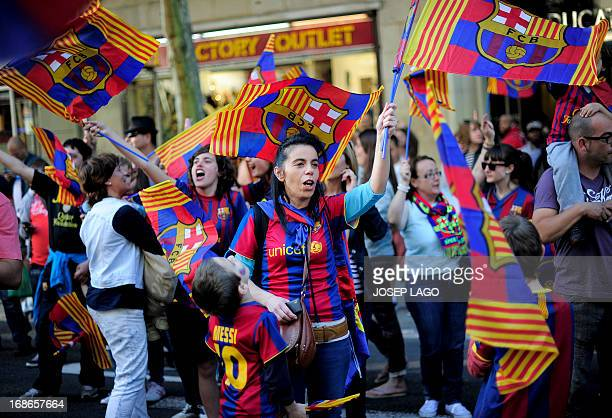 FC Barcelona's supporters wave flags as they celebrate in the streets of Barcelona on May 13 two days after their team won the Spanish league The...