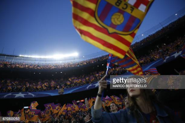 Barcelona's supporters wave flags before the UEFA Champions League quarterfinal second leg football match FC Barcelona vs Juventus at the Camp Nou...
