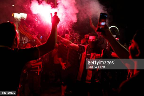 FC Barcelona's supporters wave flares as they celebrate their team's 29th Copa del Rey title at the Canaletes fountain on Las Ramblas in Barcelona on...