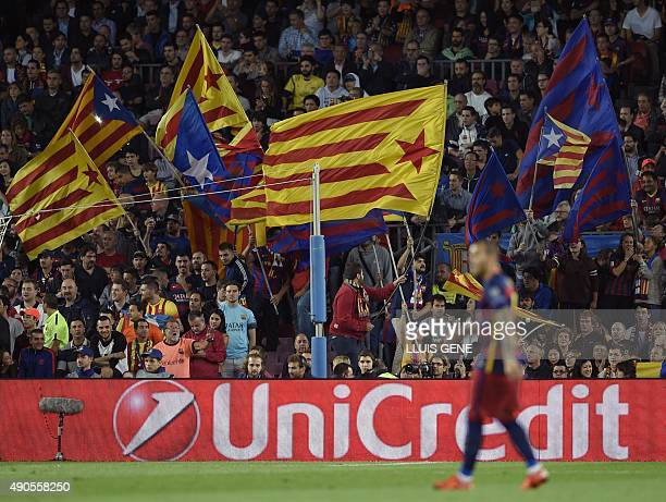 Barcelona's supporters wave pro independece flags during the UEFA Champions League Group E football match between FC Barcelona and Bayer Leverkusen...