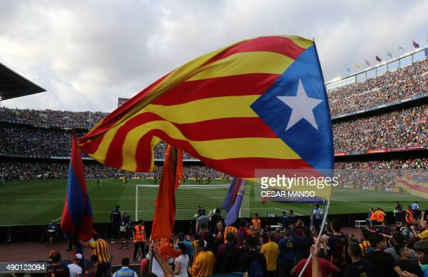 Barcelona's supporters wave the 'Estelada' proindependent Catalonia flag during the Spanish league football match FC Barcelona vs UD Las Palmas at...