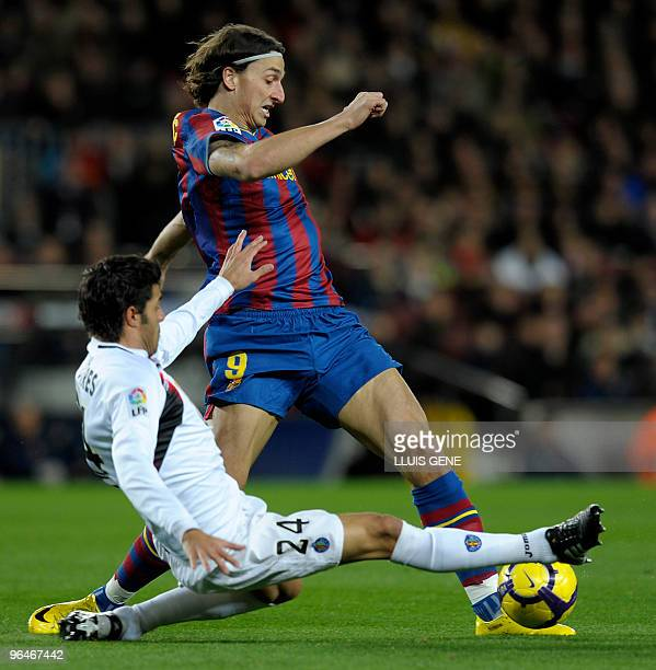 Barcelona's Swedish forward Zlatan Ibrahimovic vies with Getafe's defender Miguel Torres during their Spanish League football match on February 6...