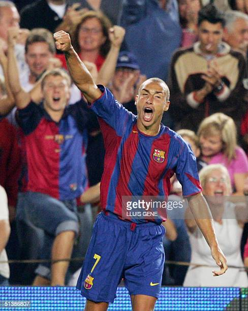 Barcelona's Swedish Herik Larsson celebrates his goal against CD Numancia during their Spanish League football match at the Camp Nou stadium in...