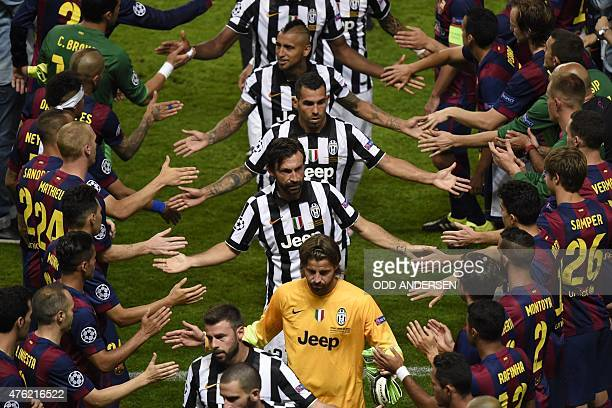 Barcelona's team congratulate Juventus' midfielder Andrea Pirlo Juventus' Argentinian forward Carlos Tevez after they were defeated during the UEFA...