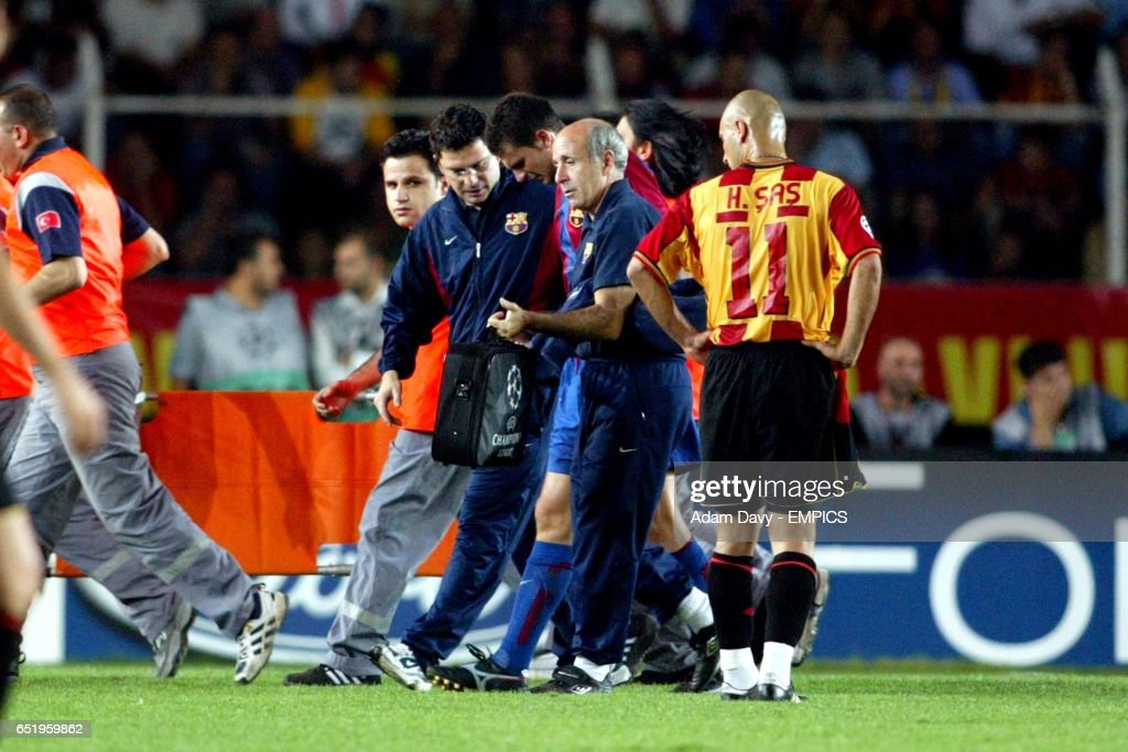 http://media.gettyimages.com/photos/barcelonas-thiago-motta-is-led-off-the-pitch-to-receive-treatment-for-picture-id651959862