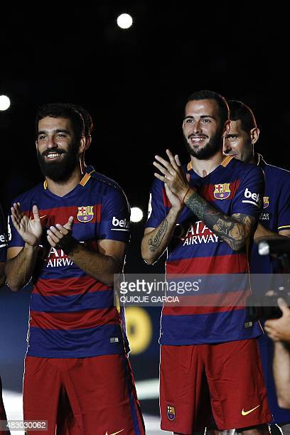 Barcelona's Turkish midfielder Arda Turan and Barcelona's defender Aleix Vidal stand during an official team presentation at the 50th Joan Gamper...