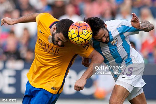 Barcelona's Turkish midfielder Arda Turan vies with Malaga's Argentinian defender Marcos Alberto Angeleri during the Spanish league football match...
