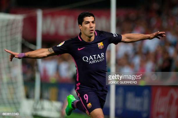 TOPSHOT Barcelona's Uruguayan forward Luis alberto Suarez celebrates after scoring during the Spanish league football match Granada FC vs FC...