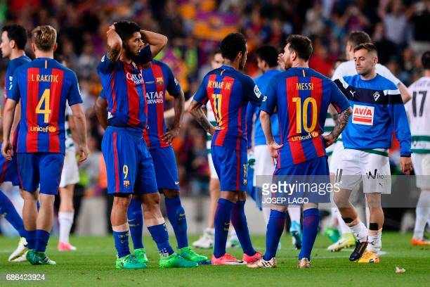 Barcelona's Uruguayan forward Luis Suarez and Barcelona's Argentinian forward Lionel Messi gesture at the end of the Spanish league football match FC...