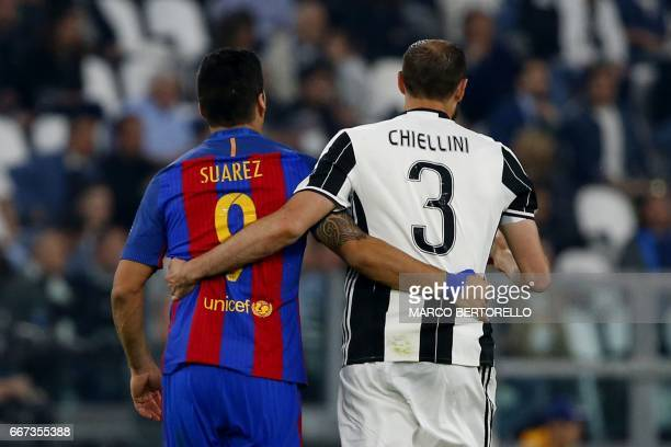 TOPSHOT Barcelona's Uruguayan forward Luis Suarez and Juventus' defender from Italy Giorgio Chiellini walk together during the UEFA Champions League...