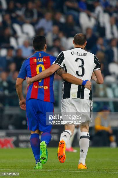 Barcelona's Uruguayan forward Luis Suarez and Juventus' defender from Italy Giorgio Chiellini walk together during the UEFA Champions League quarter...