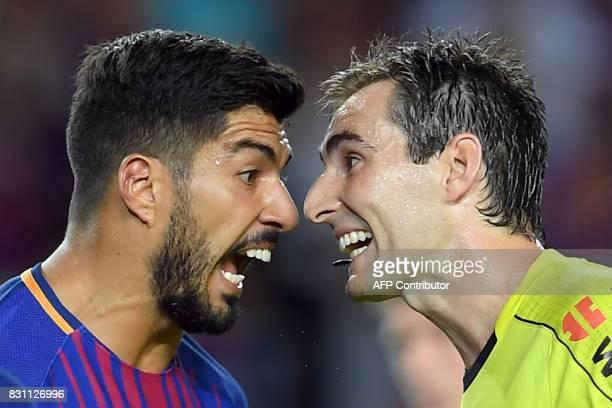 TOPSHOT Barcelona's Uruguayan forward Luis Suarez argues with referee Ricardo de Burgos Bengoetxea during the Spanish Supercup first leg football...