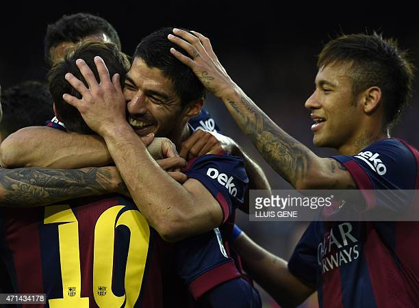Barcelona's Uruguayan forward Luis Suarez Barcelona's Brazilian forward Neymar da Silva Santos Junior and Barcelona's Argentinian forward Lionel...