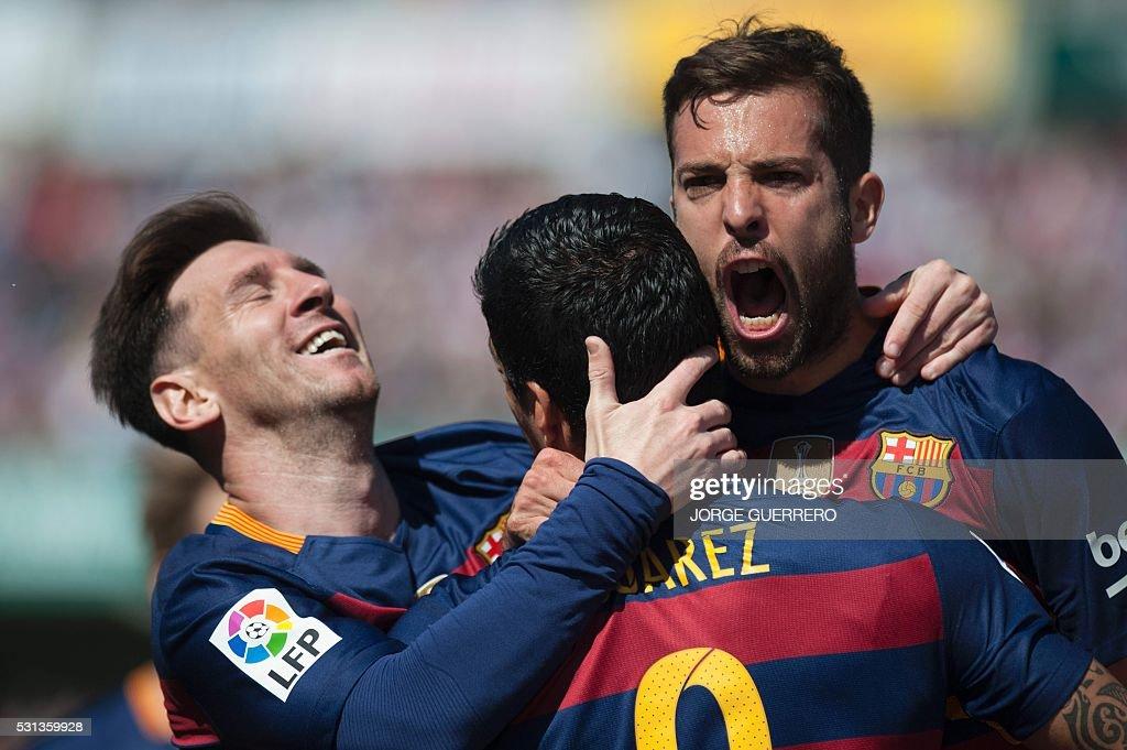 TOPSHOT Barcelona's Uruguayan forward Luis Suarez ccelebrates a goal with Barcelona's defender Jordi Alba and Barcelona's Argentinian forward Lionel...
