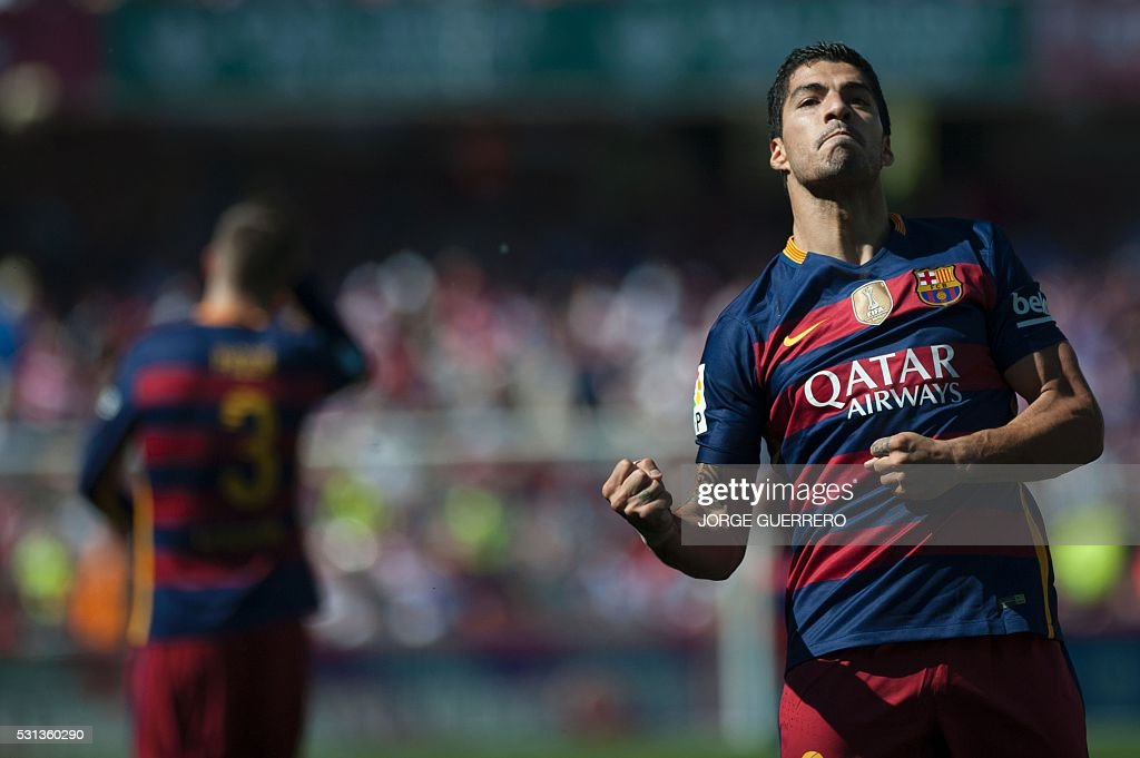 Barcelona's Uruguayan forward Luis Suarez celebrates a goal during the Spanish league football match Granada FC vs FC Barcelona at Nuevo Los Carmenes...