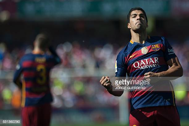 Barcelona's Uruguayan forward Luis Suarez celebrates a goal during the Spanish league football match Granada FC vs FC Barcelona at Nuevo Los Carmenes...